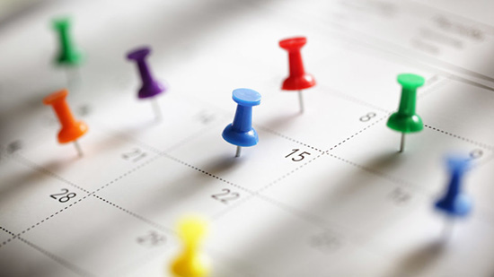 colored pins on calendar dates